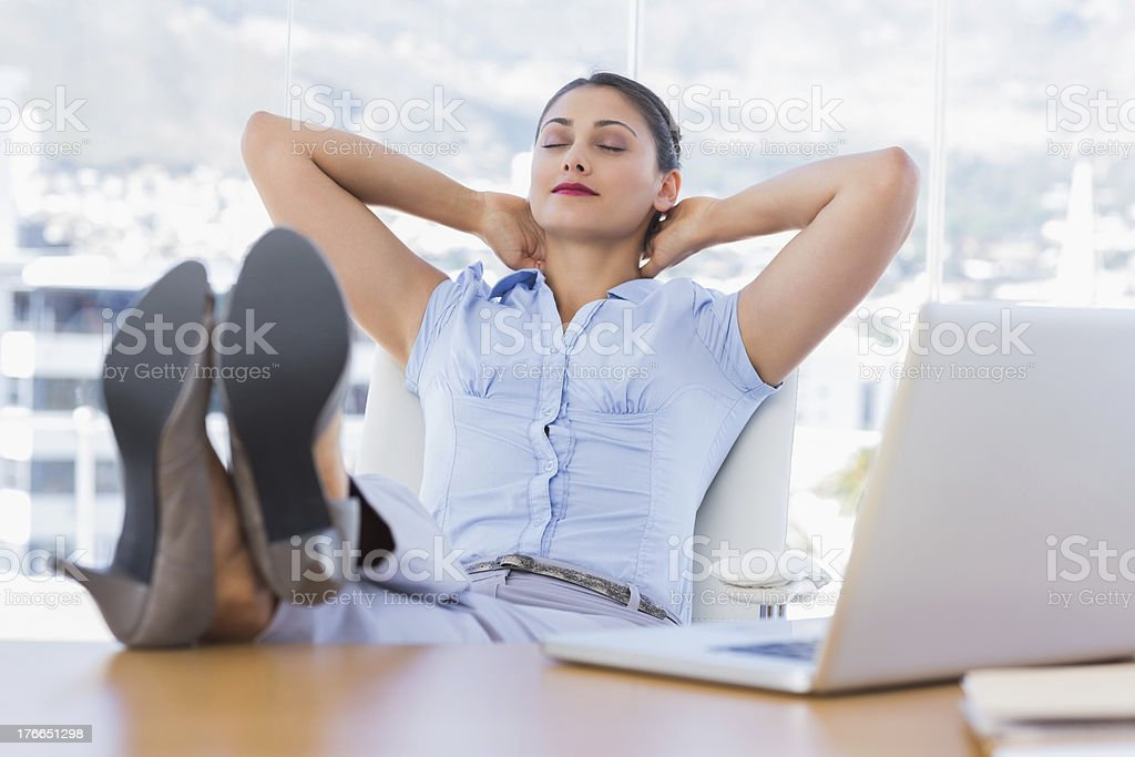 Attractive businesswoman relaxing in her office royalty-free stock photo