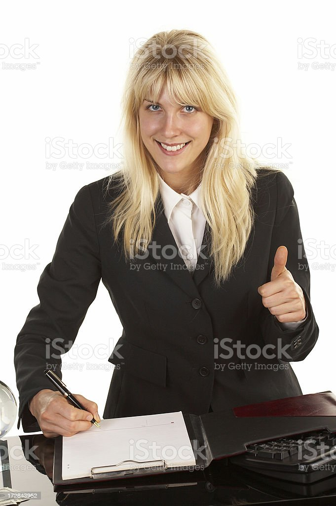 Attractive Businesswoman Signing a Contract royalty-free stock photo