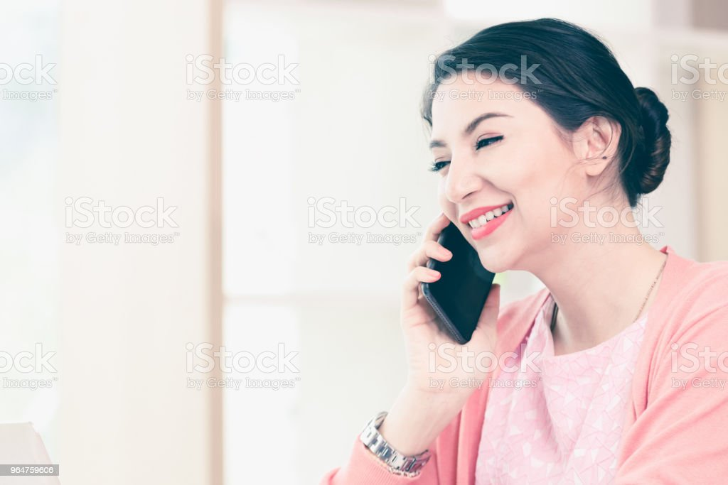 attractive businesswoman sitting working royalty-free stock photo
