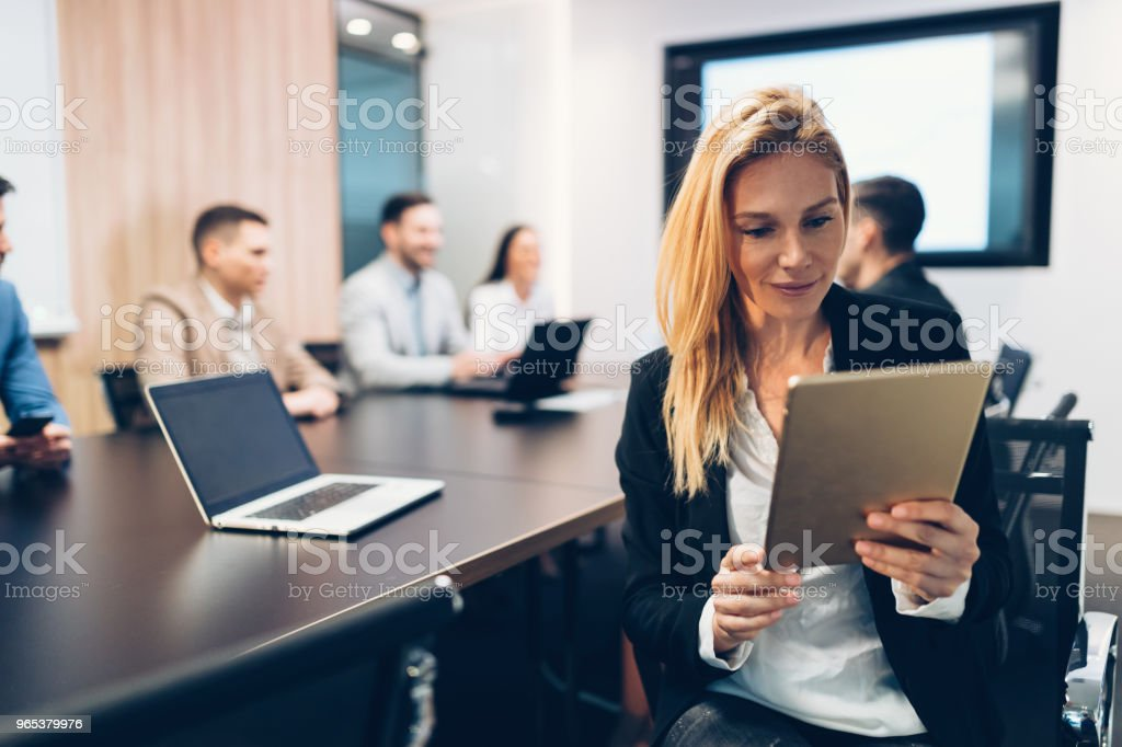 Attractive businesswoman using digital tablet in office royalty-free stock photo