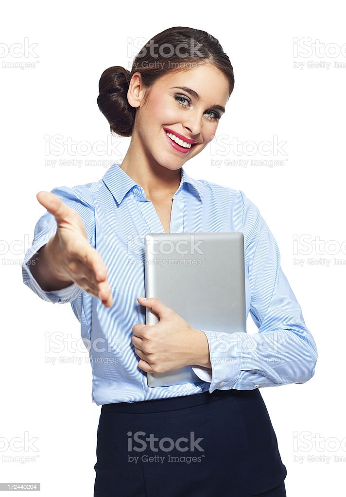 Attractive businesswoman with a digital tablet Portrait of excited businesswoman holding a digital tablet and ofering handshake. Studio shot on a white background. 20-24 Years Stock Photo