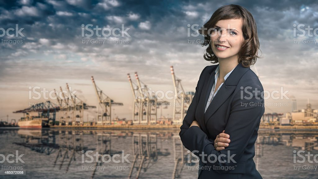 Attractive businesswoman with curly brown hair royalty-free stock photo