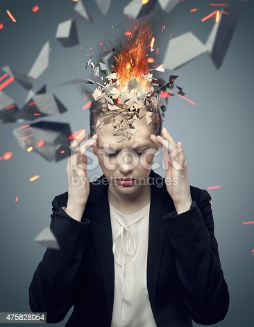 istock Attractive businesswoman with exploding headache 475828054