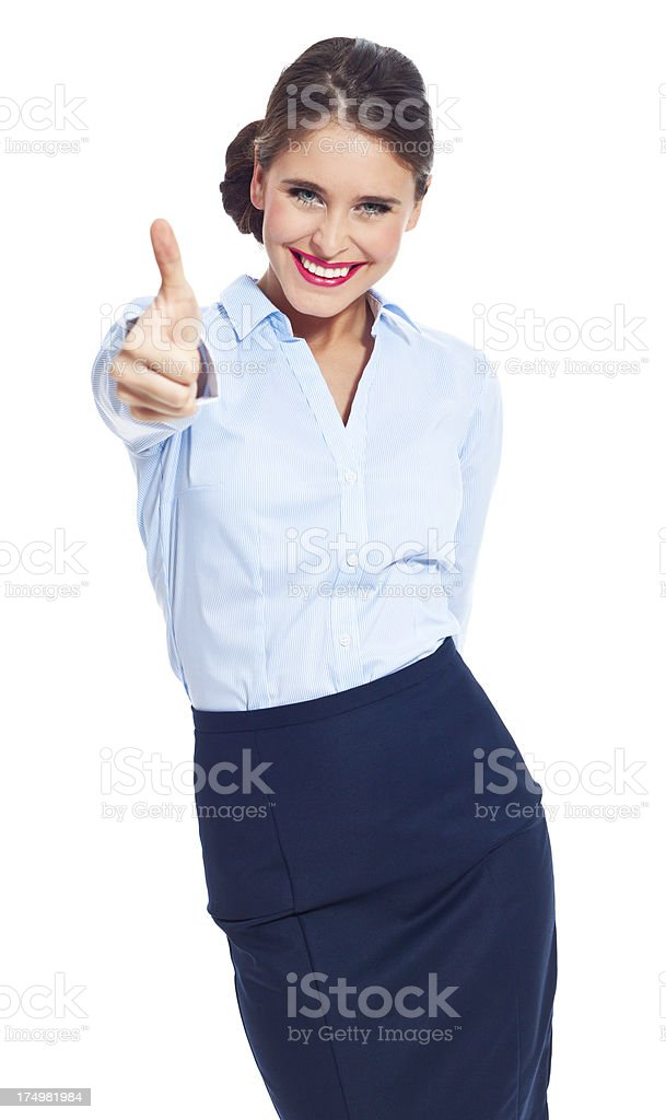 Attractive businesswoman with thumb up Portrait of excited businesswoman standing against white background with thumb up, laughing at the camera. 20-24 Years Stock Photo