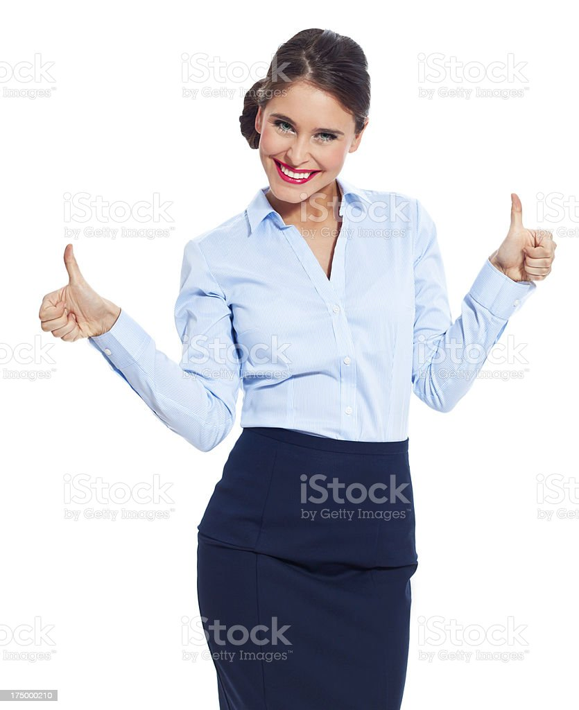 Attractive businesswoman with thumb up Portrait of happy businesswoman standing against white background with thumb up, smiling at the camera. 20-24 Years Stock Photo