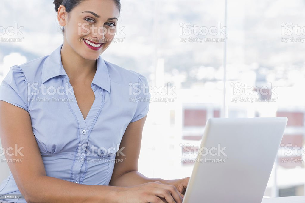 Attractive businesswoman working on her laptop royalty-free stock photo