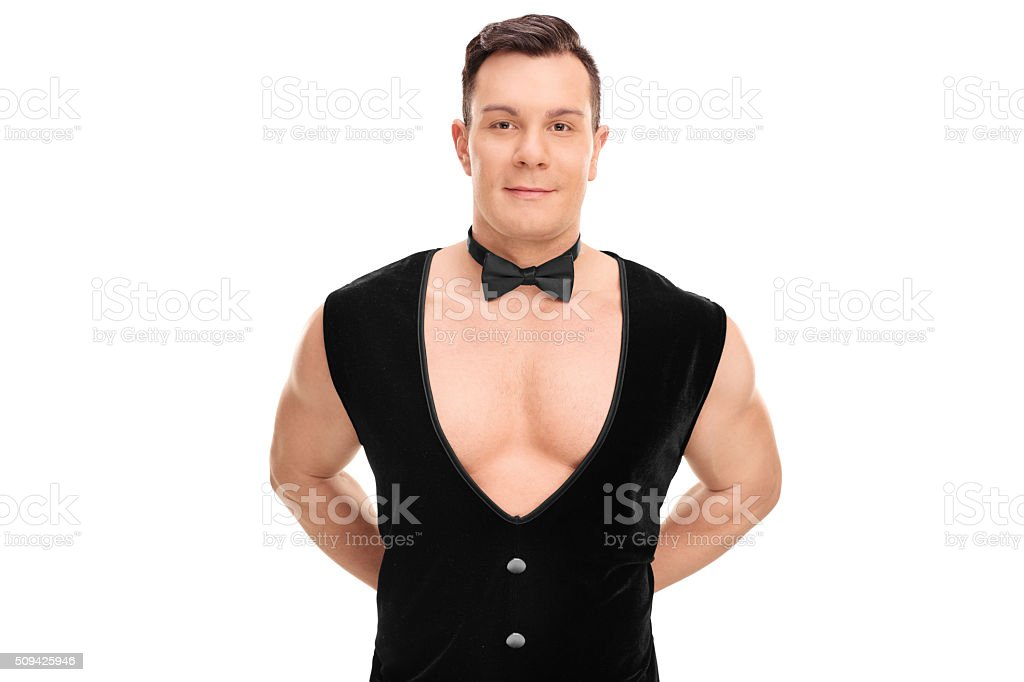 Attractive butler with a black vest and bow-tie stock photo