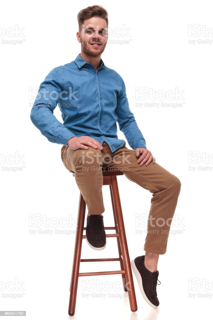Awesome Attractive Casual Man Wearing Blue Shirt Sits On Wooden Ocoug Best Dining Table And Chair Ideas Images Ocougorg