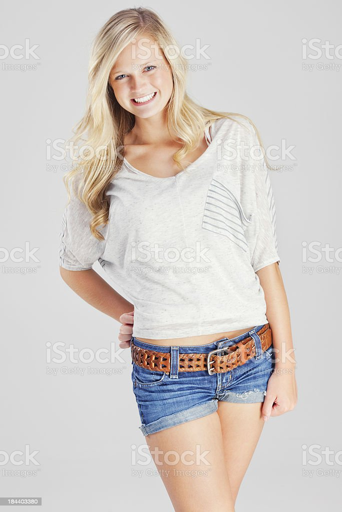 Attractive Casual Young Blonde Woman on Gray Backdrop royalty-free stock photo