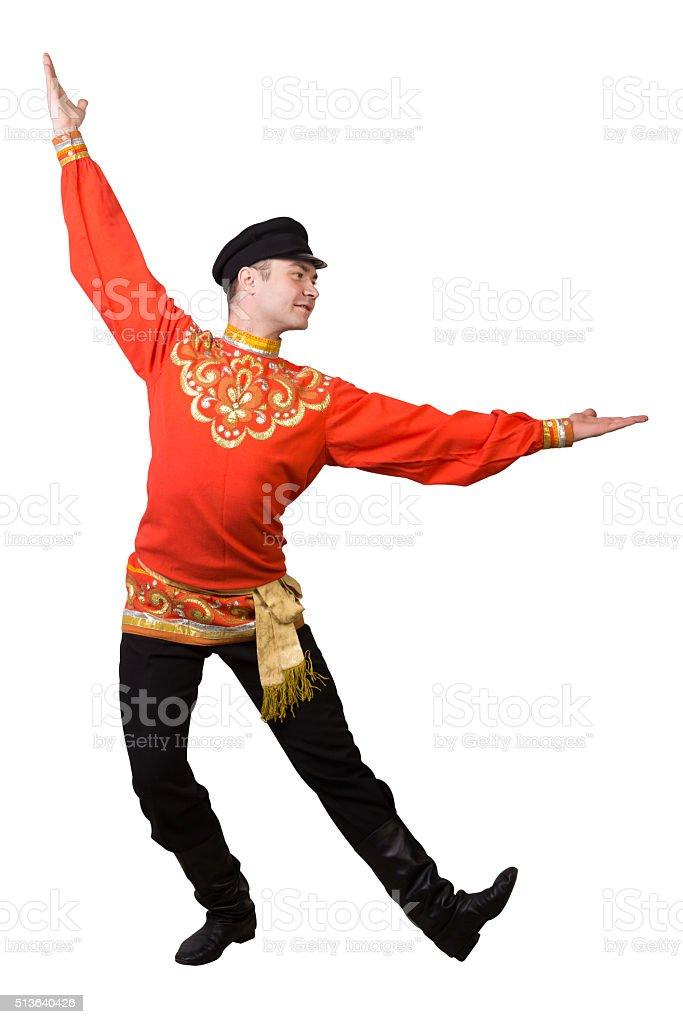attractive caucasian guy dancing in folk costume stock photo