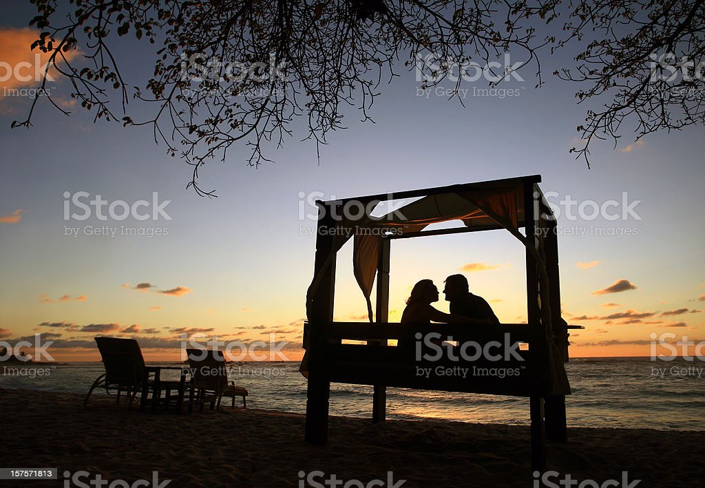 Attractive Caucasian Heterosexual Couple Enjoying Romantic Evening at Luxury Resort stock photo