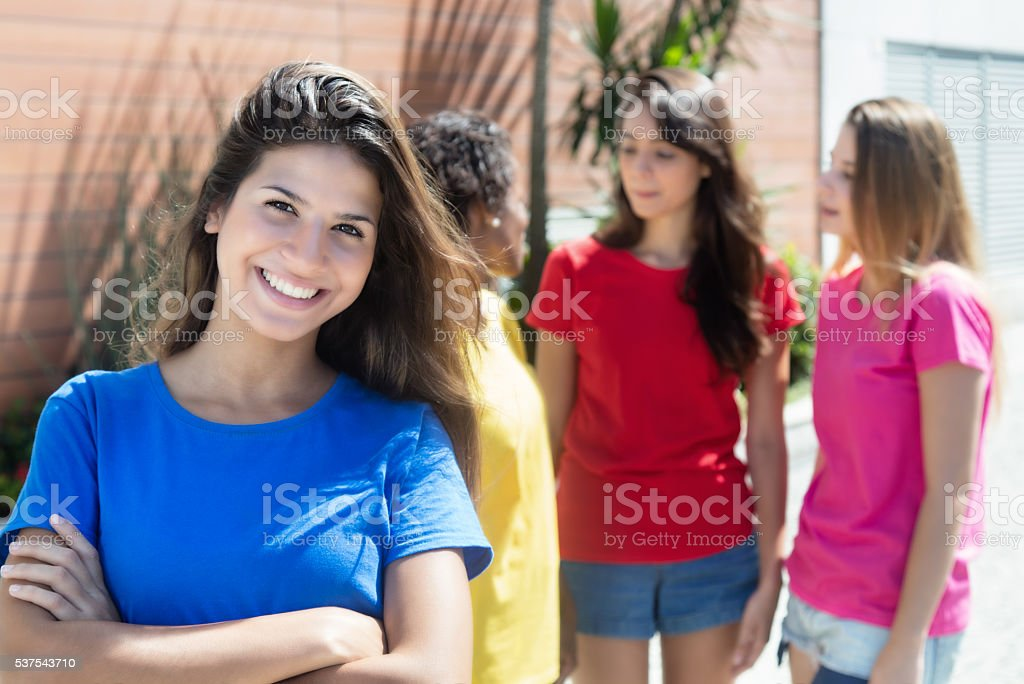 Attractive caucasian woman with three girlfriends in the city stock photo