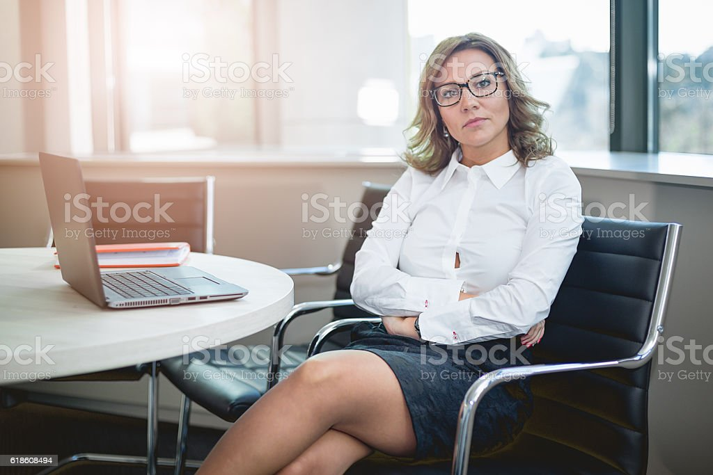 attractive CEO businesswoman in her big office