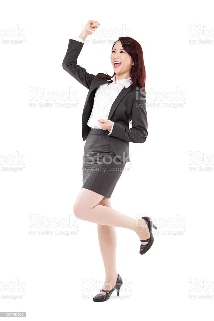 Attractive Chinese Businesswoman Celebrating Arm Rised on White Background stock photo