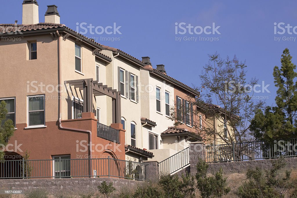 Attractive Colorful Stucco Apartment Building Exterior and Sky royalty-free stock photo