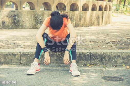 istock Attractive confidence asian woman runner resting tired after a run 861801396