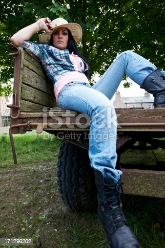 Attractive country girl in straw hat