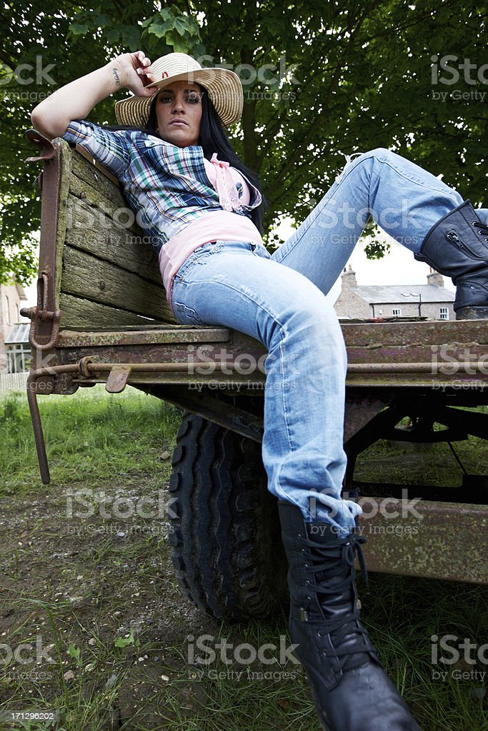 Attractive country girl in straw hat stock photo