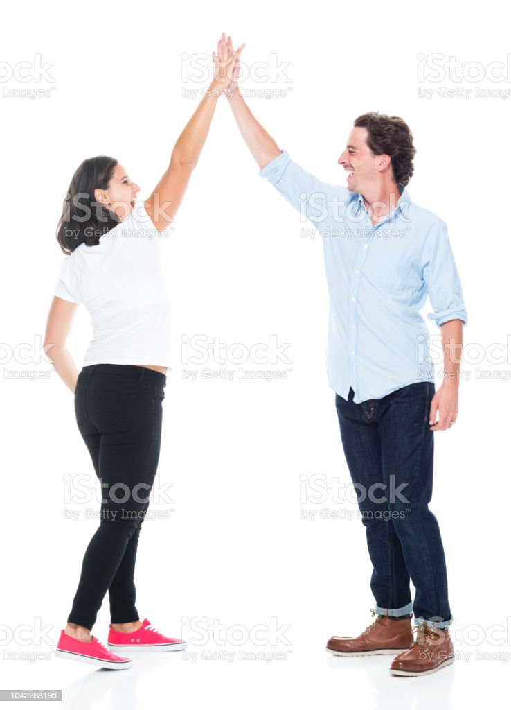 Attractive couple are doing a high five and celebrating stock photo