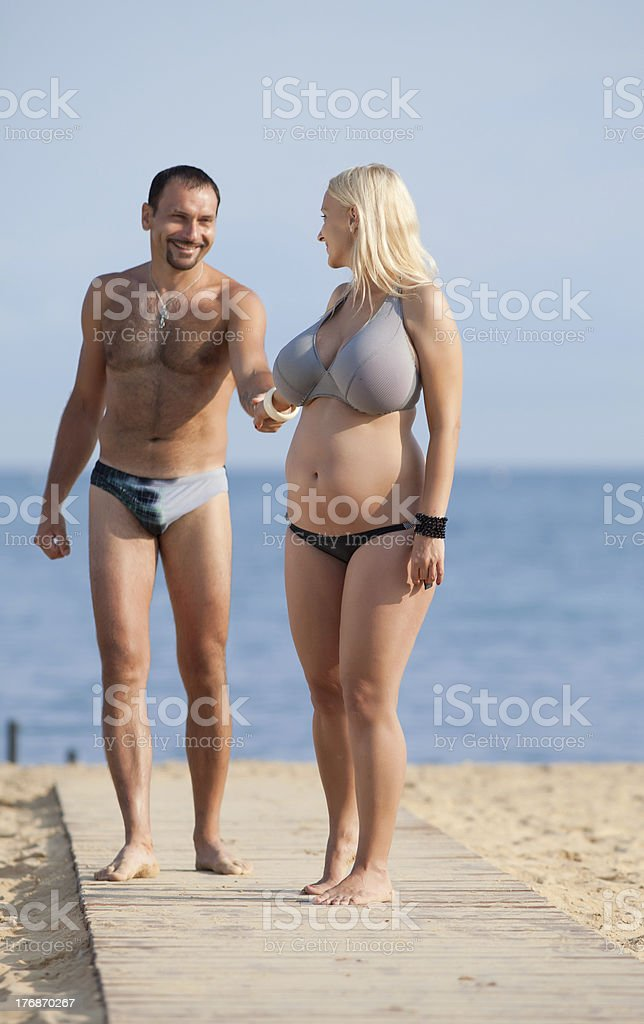 Attractive couple at the sea bildbanksfoto