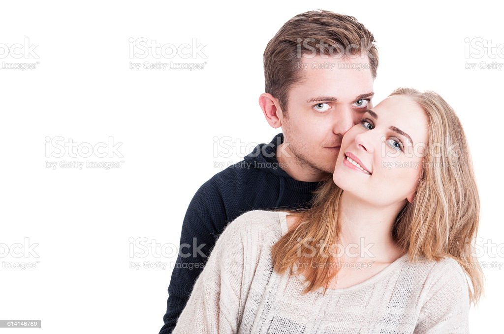 Attractive couple being affective and looking happy stock photo