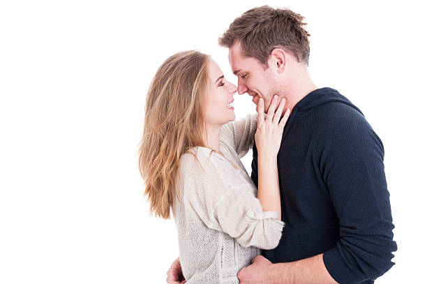Attractive couple being affective and looking happy Attractive couple being affective and looking happy wearing fall clothes isolated on white background with copy text space affective stock pictures, royalty-free photos & images