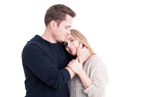 Attractive couple being supportive and affective Attractive couple being supportive and affective wearing autumn clothes isolated on white background with copy text space affective stock pictures, royalty-free photos & images