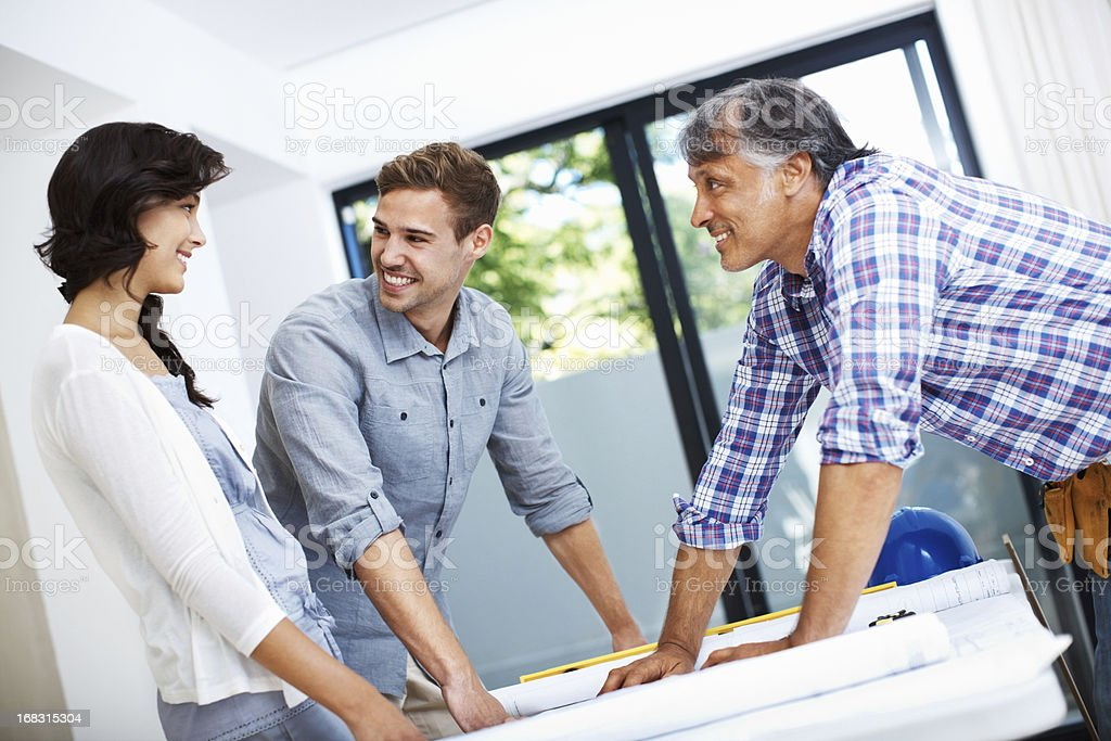 Attractive couple consulting architect royalty-free stock photo