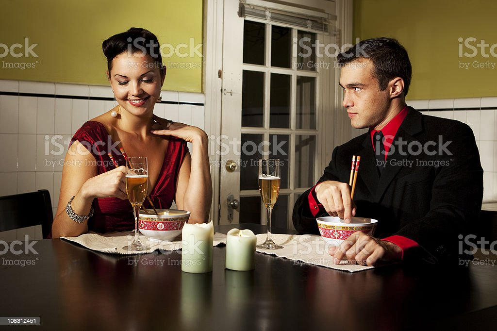 Attractive couple eating dinner royalty-free stock photo