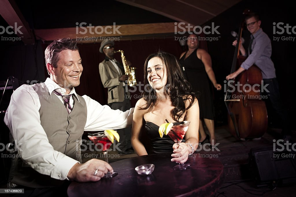 Attractive Couple Enjoying Drinks at Nightclub Bar royalty-free stock photo