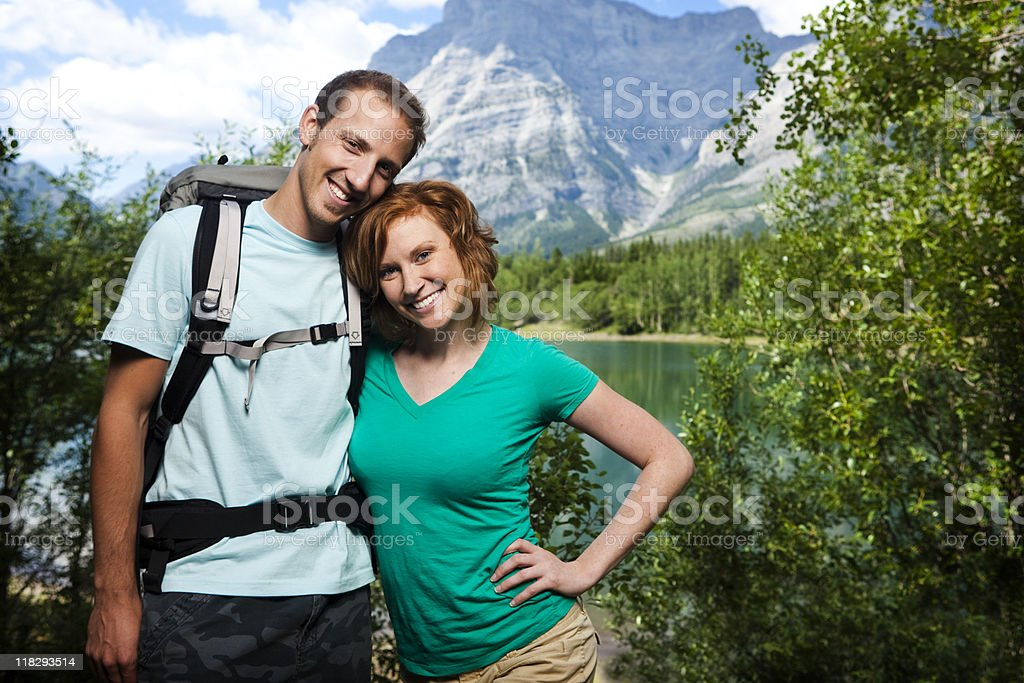 Attractive Couple Hiking in the Mountains royalty-free stock photo