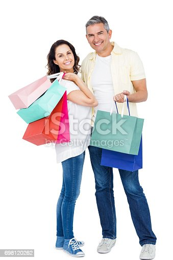 istock Attractive couple holding shopping bags 698120262