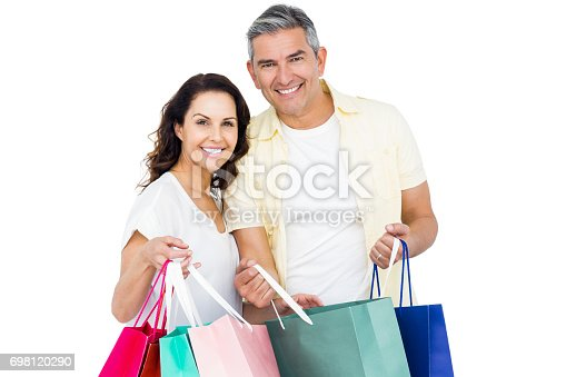 istock Attractive couple holding shopping bags 698120290