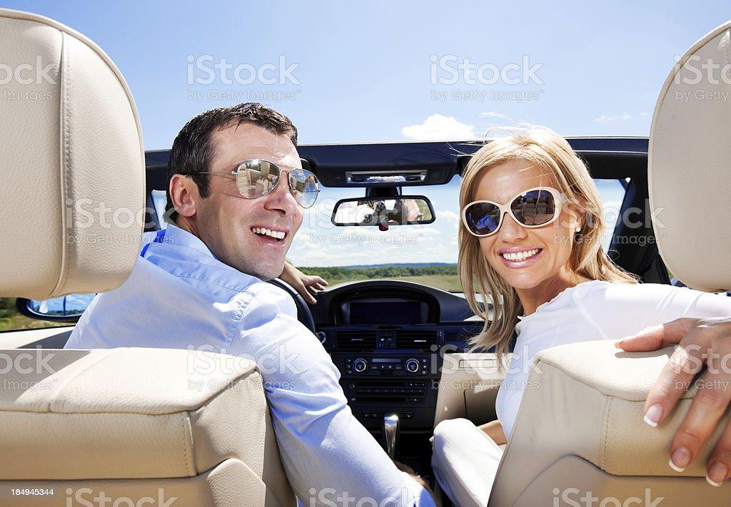 Attractive Couple in a Convertible Car stock photo