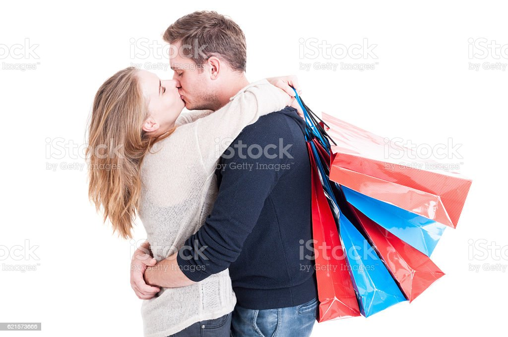 Attractive couple kissing holding bunch of shopping bags photo libre de droits