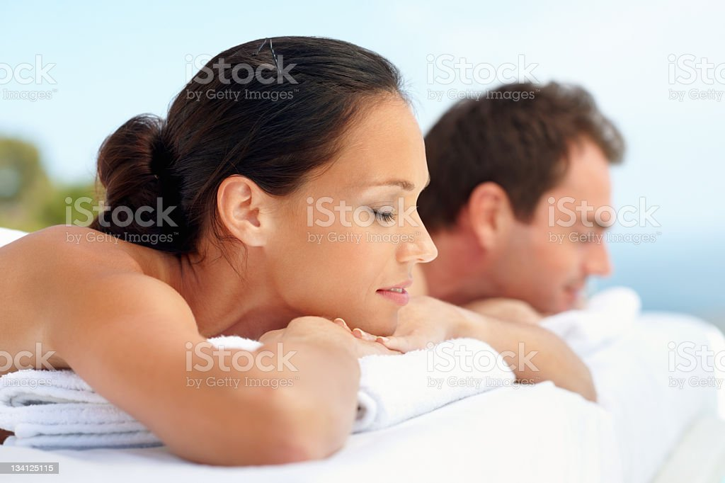 Attractive couple lying down at spa royalty-free stock photo