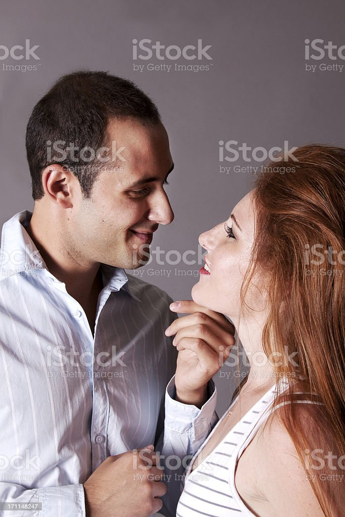Attractive Couple: Man Smiling and Touching the Woman stock photo