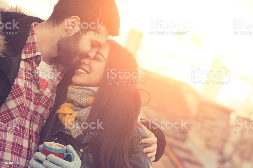 Attractive couple outdoors on a coffee break. stock photo