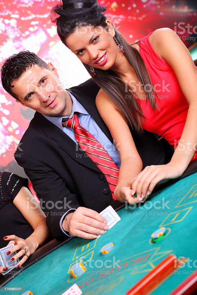 Attractive couple playing Blackjack in casino. royalty-free stock photo