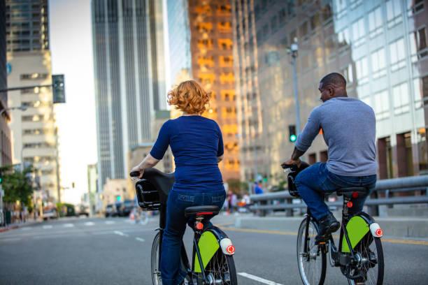 Attractive LA Couple Riding Share Bikes stock photo
