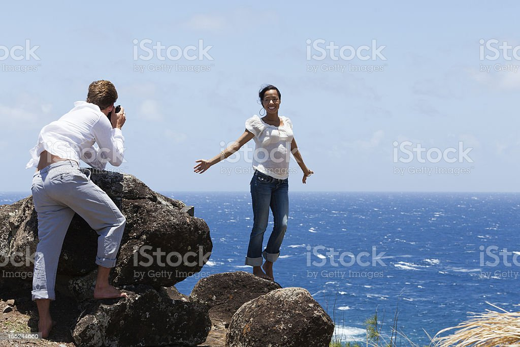 Attractive Couple Take Photo on Cliff in Hawaii stock photo