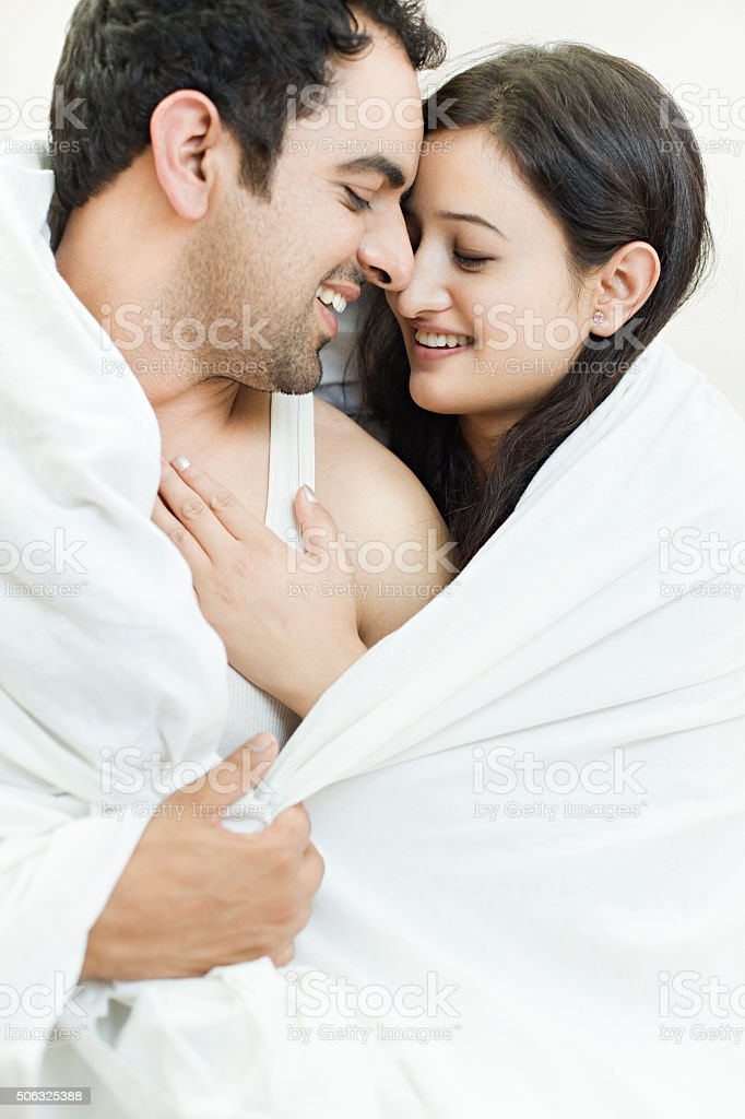 Attractive couple together on bed doing romance  royalty free stock photo. Attractive Couple Together On Bed Doing Romance stock photo   iStock