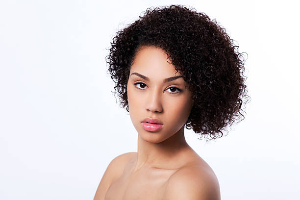 Attractive curly haired woman stock photo