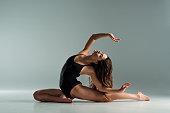 istock attractive dancer in black bodysuit dancing contemporary on grey background 1195081270