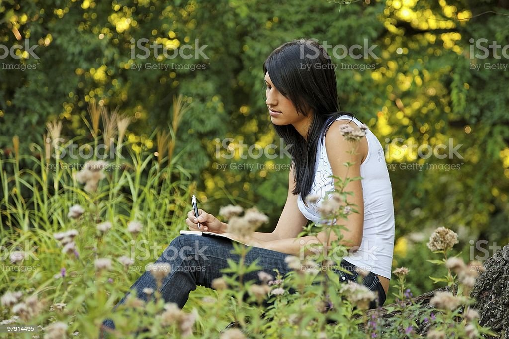 attractive diarist girl stock photo