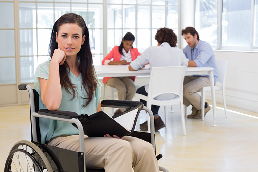 660681964 istock photo Attractive disabled businesswoman at work 832505724
