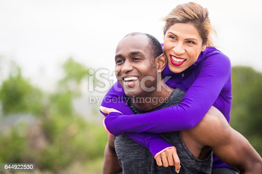 istock Attractive Diverse Couple Working Out 644922530