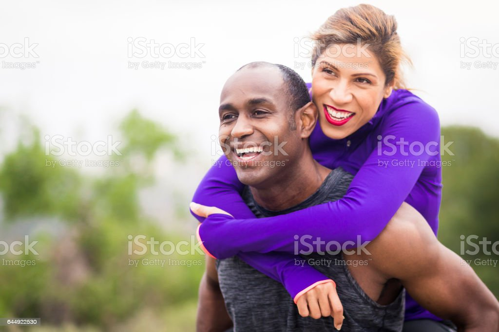 Attractive Diverse Couple Working Out stock photo