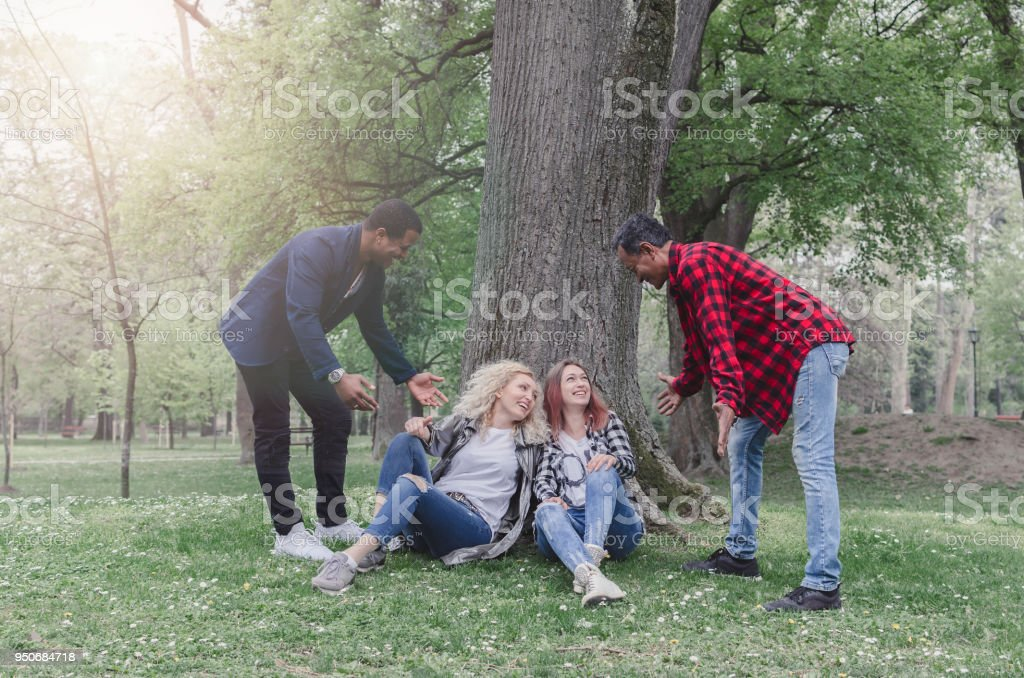 Attractive diversity people having first date. stock photo