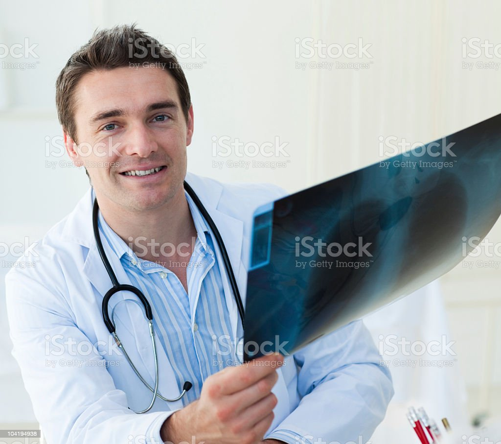 Attractive doctor examining an x-ray royalty-free stock photo